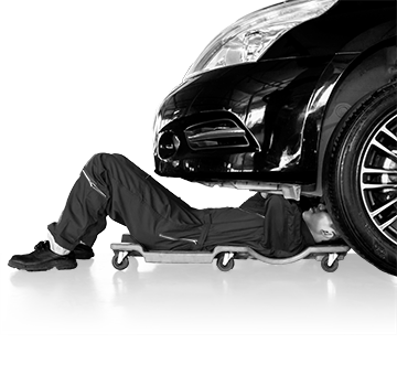 Mechanic servicing under a car